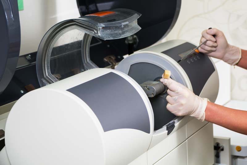 Image of hands preping CEREC® machine at Reich Dental Center – Roswell in Roswell, GA.